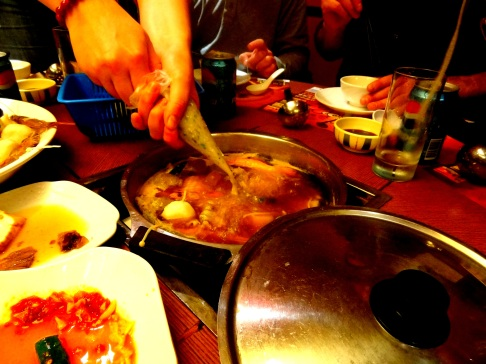 Sausage Meat being squirted into Hot Pot, Hong Kong